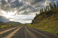 Landweg in Siberië Stock Foto's