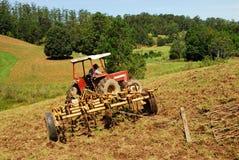 Landwirt auf Traktor Lizenzfreies Stockfoto