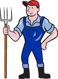 Landwirt-Holding Pitchfork Standing-Karikatur Stockfoto