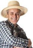 Landwirt mit einem wenig Schwarzen piggy lizenzfreies stockfoto