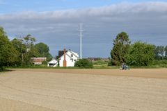 Landwirt Working Field Richmonds, Kanada stockbilder
