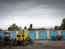 Farm yard, old garages with blue doors royalty free stock images