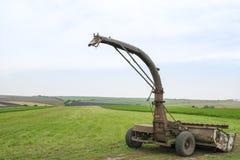 Landwirtschaftliche Maschine auf dem Gebiet Lizenzfreie Stockfotografie