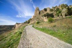 Landwirtschaftliche Straße in der Andalusien-Landschaft Stockfotografie