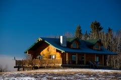Landwirtschaftliches hölzernes Haus Stockfotografie