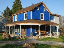 Landwirtschaftliches Land-Haus Stockfoto