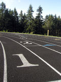 Lane 1. A runner's view of lane one on a high school track Stock Photos