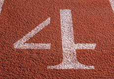 Lane 4. The number 4 at a lane on a running track Stock Image