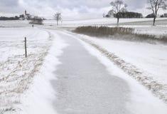Lane across wintry field Royalty Free Stock Photo