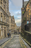 Lane in Edinburgh Old Town. A quaint   cobbled lane in the historic Edinburgh Old Town, leading from the  Royal Mile on the approach to Edinburgh Castle Royalty Free Stock Images