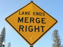 Lane ends, merge right, traffic sign with arrow. A traffic sign tells drivers the lane is ending and traffic merges to the right Stock Image