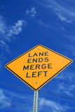 Lane Ends Road Sign. Over blue sky Stock Photo