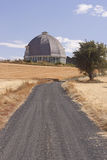Lane leads to round barn. Stock Photography