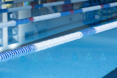 Lane marker buoys and swimming pool Royalty Free Stock Photography