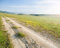 Lane in meadow and sunrise. Royalty Free Stock Photos