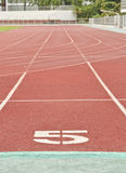 Lane number five. Number five on the start of a running track Royalty Free Stock Images
