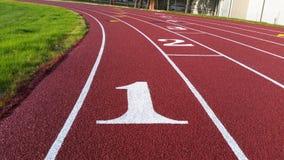 Lane 1 on outdoor running track. Lane 1 markings on an outdoor running track Royalty Free Stock Image