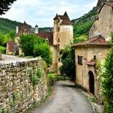 Lane through the pretty village of Autoire, France. Pretty lane through the stone houses of the village of Autoire, France Royalty Free Stock Image