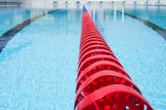 Lane rope. Plastic swimming pool lane rope floating on water surface royalty free stock photo