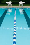 Lane separator in outdoor swimming pool Royalty Free Stock Photo
