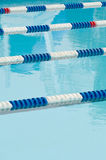 Lane separators in outdoor swimming pool Royalty Free Stock Image