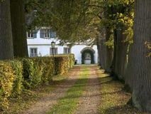Lane to farmhouse Stock Photo