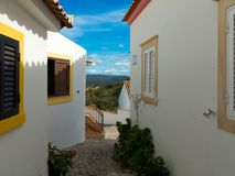 A beautiful view to the mountains through the houses of Salir in Portugal stock photos