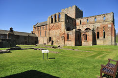 Lanercost priory ruins, Cumbria (west view). The ruins of Lanercost priory, in Brampton, Cumbria, England. The estimated date of its construction is 1169, and Royalty Free Stock Images