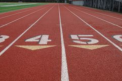 Lanes on athletic track. Numbered lanes on athletic running track with middle lanes in foreground royalty free stock image