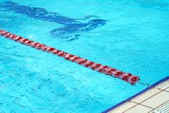Swimming pool with lanes. Lanes of a competition swimming pool. Empty swimming pool with lanes Stock Photo