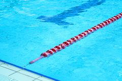 Swimming pool with lanes. Lanes of a competition swimming pool. Empty swimming pool with lanes Stock Image