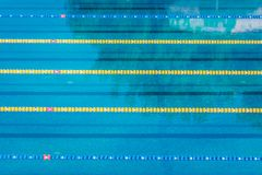 Lanes In A Competition Olympic Size Outdoor Swimming Pool. Calm Water Background. Royalty Free Stock Photography