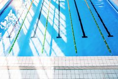 Lanes of an indoor public swimming pool. Top view royalty free stock photography