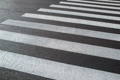 Lanes of marking a pedestrian crossing close-up Royalty Free Stock Photo