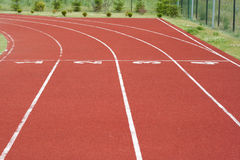 Lanes of a red race track. Photo outdoors royalty free stock images