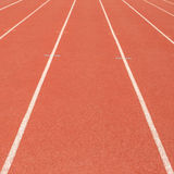 Lanes of a red race track in the stadium royalty free stock images