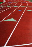 Lanes on running race track. Lanes on red running race track, with lines and arrows indicating path Stock Photography