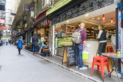 Laneway with cafes and people in Melbourne Stock Photography