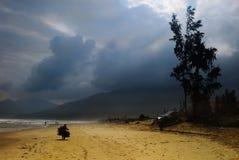 Lang Co beach. Peasant woman walking through Lang Co Beach,near Da nang,central Vietnam Royalty Free Stock Photography