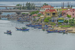Lang Co town, Hue, Vietnam. Fisherman boats in the water at fishing village Lang Co in Vietnam. View from the Hai Van pass, Hue, Vietnam Royalty Free Stock Photography