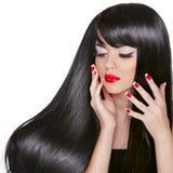 Lang haar. Mooi donkerbruin meisje met Schitterend Zwart Haar en Stock Afbeelding