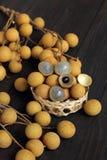 Langan fresh is fruit sweet taste. Langan fresh is fruit sweet taste  wood background Royalty Free Stock Images