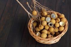 Langan fresh is fruit sweet taste. Langan fresh is fruit sweet taste  wood background Stock Photography
