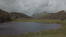 Langdale Pikes and Blea Tarn in Lake District, UK. View on the Langdale Pikes and Blea Tarn in the English Lake District in autumn stock video