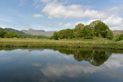 Langdale Pikes reflected in River Brathay Stock Photos