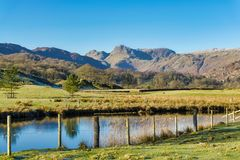 The Langdale Pikes seen from Elterwater Stock Photos