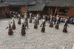 People of the Miao ethnic minority performing a traditional dance in Langde Miao Nationality  village, Guizhou province, China. Langde, China - March 27, 2018 Stock Images
