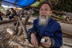 Langde Shang Miao Village, Old chinese man eating chicken egg. Stock Photography