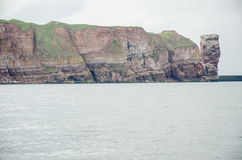 Germany-Helgoland - The Lange Anna. Lange Anna - Long Anna - Tall Anna - Stack of Buntsandstein in the North Sea island of Helgoland, Germany - Natural monument Royalty Free Stock Photos
