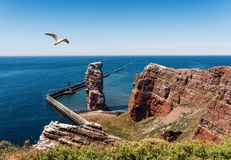 Lange Anna sea stack rock on Heligoland Island against blue sea and clear sky. High angle view of Lange Anna sea stack rock on Heligoland island against blue sea Stock Photography